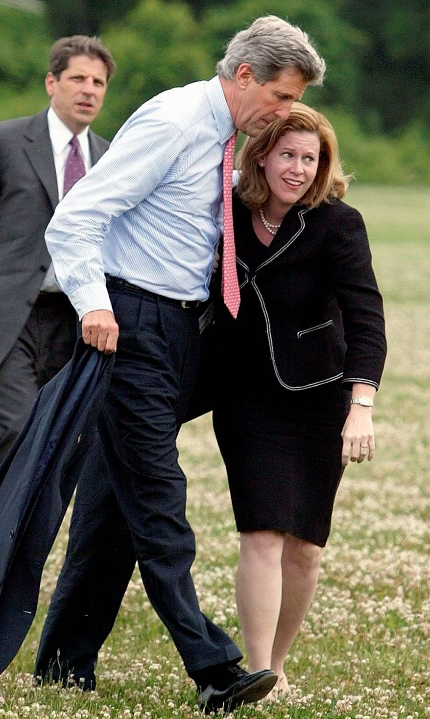 Sen. John Kerry, the Democratic presidential candidate, walks with Stephanie Cutter, a communications aide on his campaign, after exiting a helicopter in a landing zone in Red Bank, N.J., in 2004. (Associated Press)