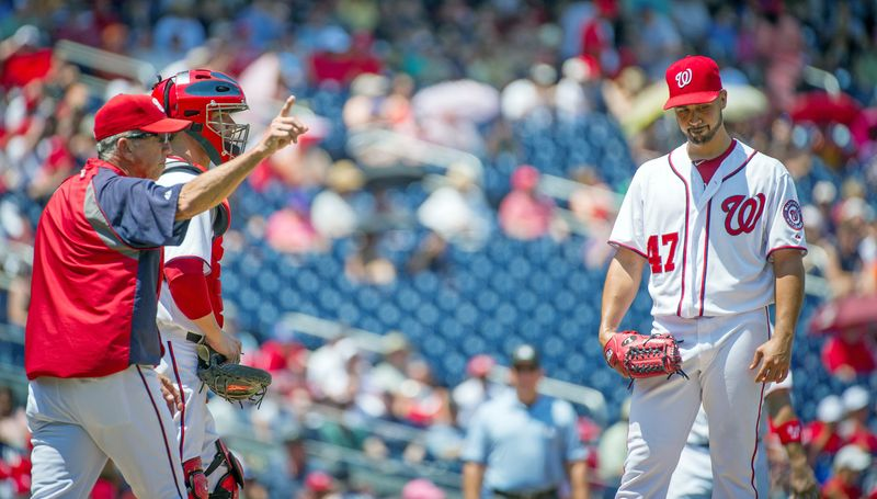 Davey Johnson gives Gio Gonzalez an early hook after the Nationals left-hander gave up six earned runs in 3.1 innings, his shortest start of the season. The Mets rolled to a 9-5 win at Nationals Park. (Rod Lamkey Jr./The Washington Times)