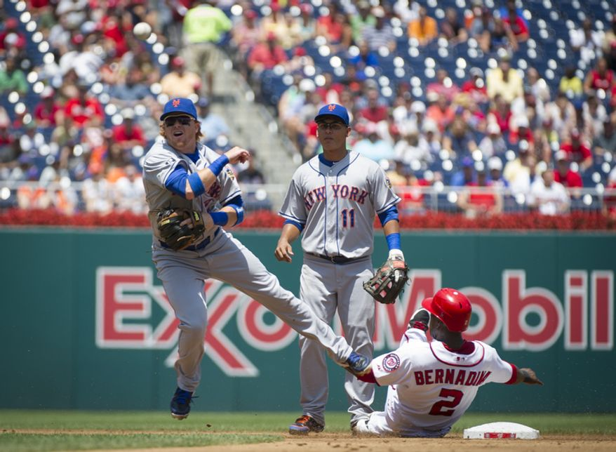 New York Mets Justin Turner makes the tag on the double play Washington Nationals Roger Bernadina is out at second base in the bottom of the second inning. (Rod Lamkey Jr./The Washington Times)