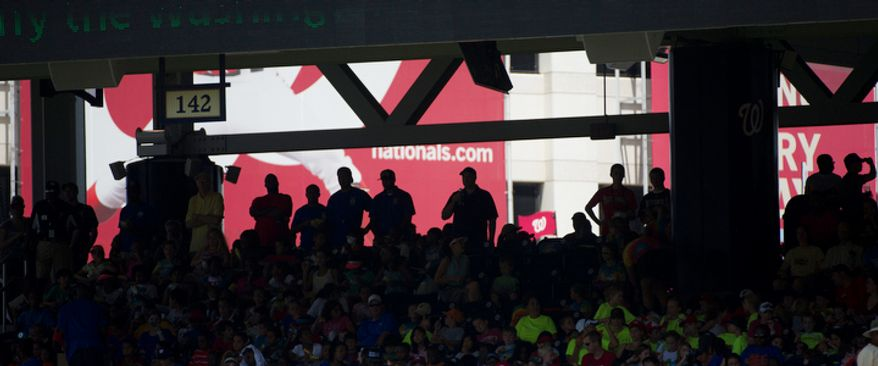 Fans seek the shelter of shade on the concourse as the Washington Nationals host the New York Mets. (Rod Lamkey Jr./The Washington Times)