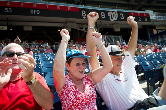 Nationals fans Pat Greaney, of Chevy Chase, Md., (left) Lary Lee (center) and her husband Blair Lee (right) of Silver Spring, Md., cheer during a brief moment of hope as the Washington Nationals host the New York Mets. (Rod Lamkey Jr./The Washington Times)