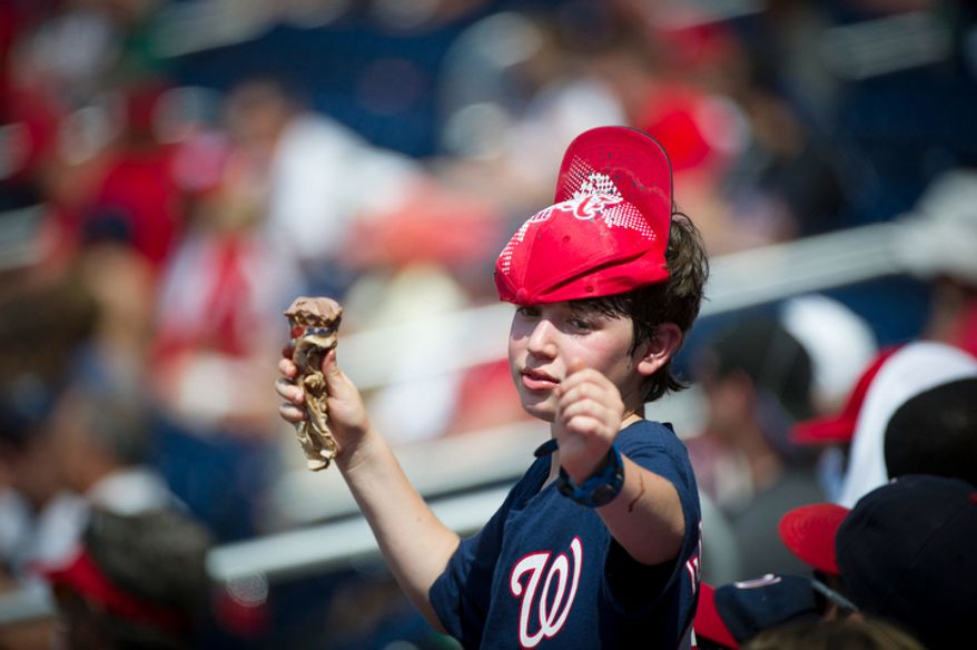 """Isaac Silber, 12, of Washington D.C. wears his """"rally cap"""" late in the game. (Rod Lamkey Jr./The Washington Times)"""