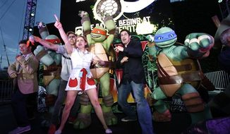 Cast members of 'Teenage Mutant Ninja Turtles' Greg Cipes, Jason Biggs, Mae Whitman, Sean Astin and Rob Paulsen pose for a photo with the turtles at the Dawn Of The Con at Petco Park during Comic-Con on Thursday, July 12, 2012, in San Diego. (Photo by Joe Kohen/Invision for Nickelodeon/AP Images)