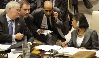 Mark Lyall Grant (left), British ambassador to the United Nations, and U.N. Ambassador Susan Rice of the United States confer at the United Nations on Thursday, July 19, 2012, during a U.N. Security Council meeting on Syria. (AP Photo/Kathy Willens)