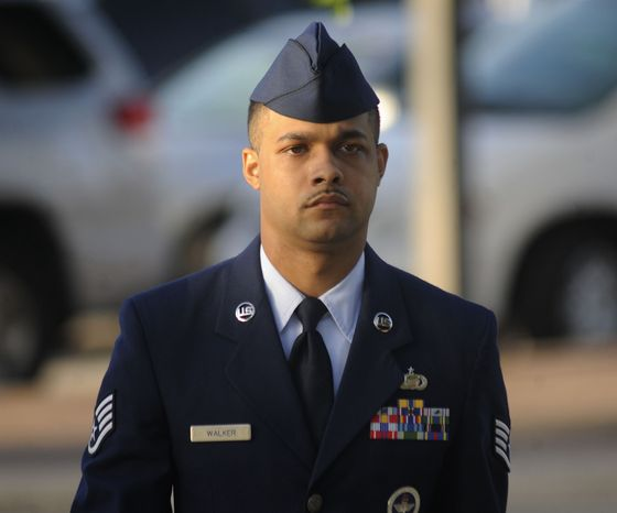 Air Force Staff Sgt. Luis Walker arrives July 20, 2012, for the fourth day of his trial at Lackland Air Force Base in San Antonio. Walker is accused of sexually assaulting 10 basic trainees, with charges ranging from rape and aggravated sexual assault to obstructing justice and violating rules of professional conduct. (Associated Press/San Antonio Express News)