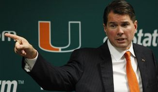 "Miami head football coach Al Golden  gestures as he speaks during a news conference, Wednesday, Feb. 1, 2012 in Coral Gables, Fla. ""We've been through a lot, with the allegations and the events of Aug. 14 and then the subsequent suspensions and distractions and kind of lack of continuity, if you will,"" Golden said. ""And then we took the bowl game (ban) so we could move forward and put that behind us. (AP Photo/Wilfredo Lee)"
