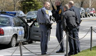 **FILE** State and local police wait April 16, 2007, for a building to be cleared by police on the Virginia Tech campus in Blacksburg, Va., following a shooting incident. (Associated Press)