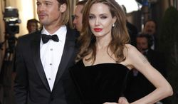 **FILE** Angelina Jolie and Brad Pitt arrive Feb. 26, 2012, before the 84th Academy Awards in Hollywood. (Associated Press)