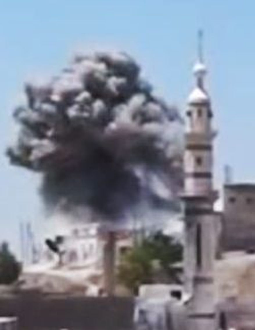 This image made from amateur video released by the Ugarit News purports to show smoke rising from artillery shelling near a mosque in Talbiseh, in the central province of Homs, Syria. (Ugarit News via Associated Press)