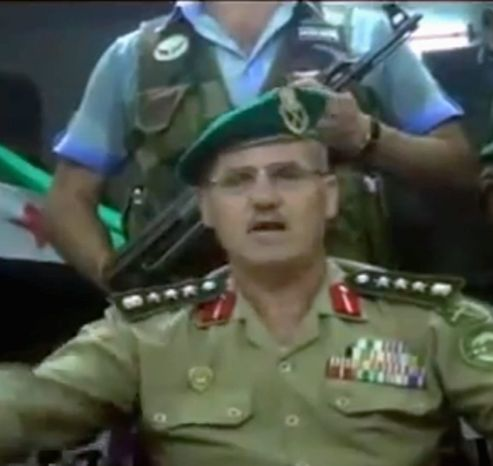 This image made from amateur video released by the Ugarit News purports to show Syrian Brig. Gen. Abdul-Nasser Farzat, from the Aleppo Academy for Military Engineering, claiming to have defected. (Ugarit News via Associated Press)