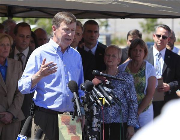 Colorado Gov. Jon Hickenlooper talks during a news conference at the Century 16 theatre east of the Aurora Mall in Aurora, Colo., on Friday, July 20, 2012. A gunman in a gas mask hurled a gas canister and opened fire in the sold-out theater during a midnight showing of the new Batman movie Friday. (AP Photo/David Zalubowski)