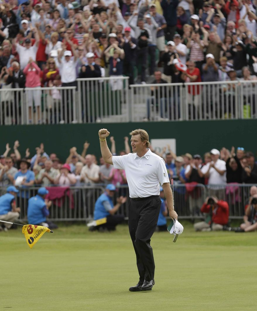 Ernie Els of South Africa reacts after putting on the 18 green at Royal Lytham & St Annes golf club during the final round of the British Open Golf Championship, Lytham St Annes, England, Sunday, July 22, 2012. (AP Photo/Peter Morrison)