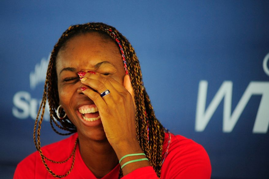 Venus Williams laughs during a press conference before a match between the Washington Kastles and the Kansas City Explorers.  (Ryan M.L. Young/The Washington Times)