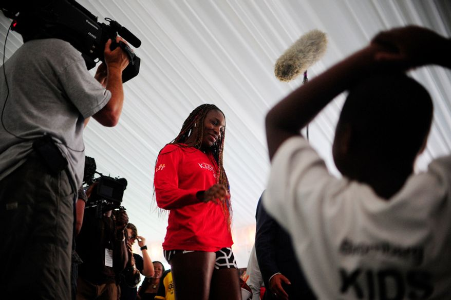 Venus Williams speaks to a group of children before playing in a World Team Tennis match between the Washington Kastles and the Kansas City Explorers.  (Ryan M.L. Young/The Washington Times)
