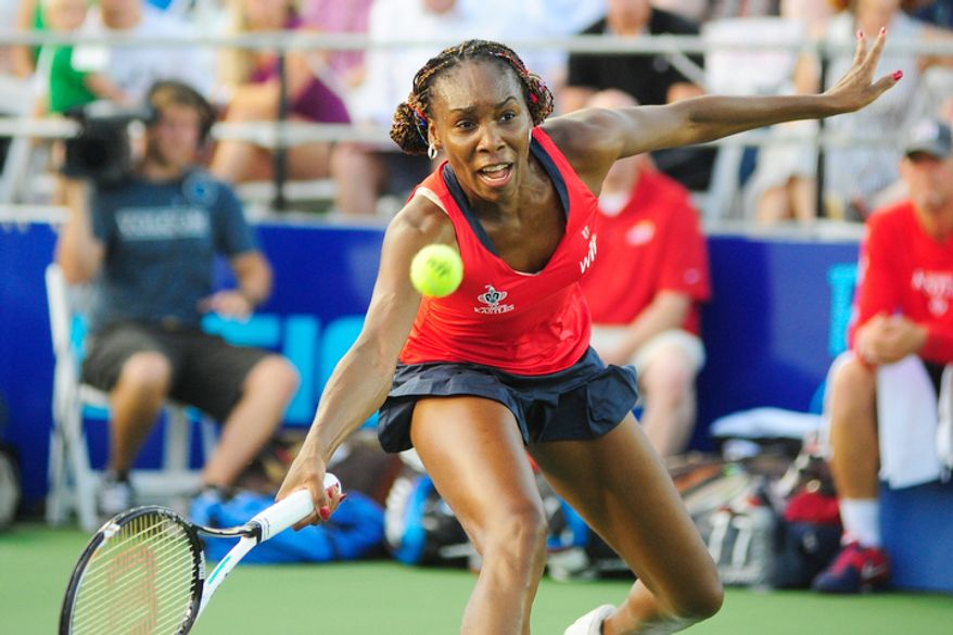 Venus Williams hits a ball while playing in a World Team Tennis match between the Washington Kastles and the Kansas City Explorers.   (Ryan M.L. Young/The Washington Times)