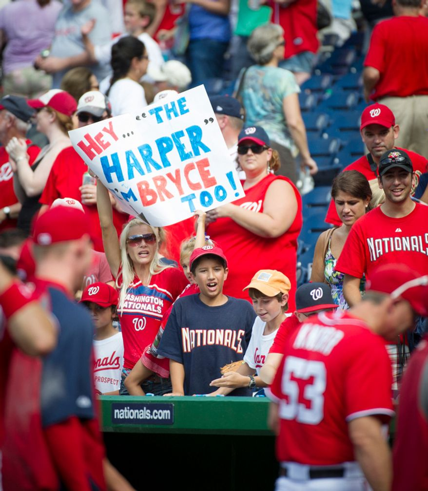 A woman in the stands cheers as she holds her sign above the Nationals' dugout after the Washington Nationals defeated the Atlanta Braves 9-2 at Nationals Park in Washington, D.C., Sunday, July 22, 2012. (Rod Lamkey Jr./The Washington Times)
