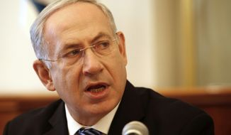 Israeli Prime Minister Benjamin Netanyahu opens the weekly Cabinet meeting at his office in Jerusalem on Sunday, July 22, 2012. (AP Photo/Gali Tbbon, Pool)