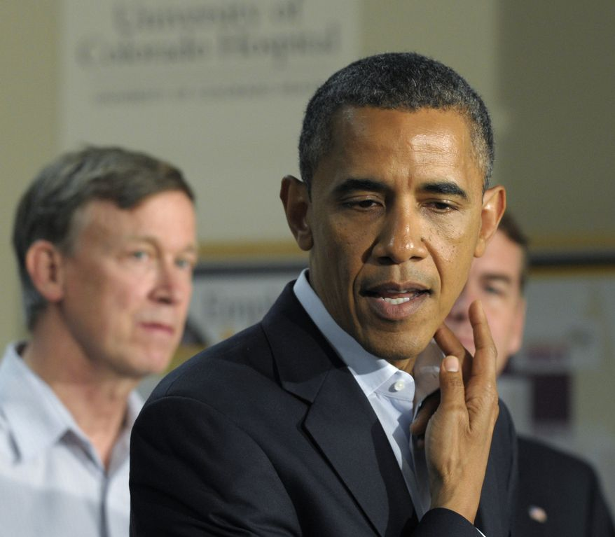 President Obama talks about one of the victims and her injury during a statement from the University of Colorado Hospital in Aurora, Colo., Sunday, July 22, 2012, after visiting with families of victims of the movie theater shooting as well as local officials. Colorado Gov. John Hickenlooper is at left. (AP Photo/Susan Walsh)