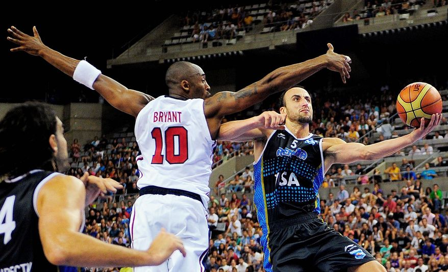 Kobe Bryant of the United States tries to block a shot by Manu Ginobili of Argentina during their exhibition game in Barcelona, Spain. The Americans, gearing up for the London Olympics, won 86-80 on Sunday. (Associated Press)