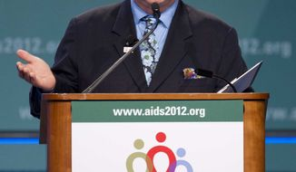 Sir Elton John speaks at the XIX International AIDS Conference, Monday, July 23, 2012, in Washington. (AP Photo/Carolyn Kaster)