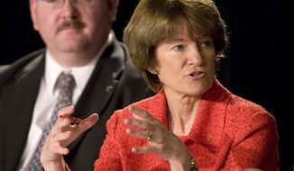 ** FILE ** In this July 28, 2009 photo, former astronaut Dr. Sally Ride, with Jeffrey Greason in the background, comments during a meeting of the Review of U.S. Human Space Flight Plans Committee. Ride, the first American woman in space, died Monday, July 23, 2012 after a 17-month battle with pancreatic cancer. She was 61. (AP Photo/Houston Chronicle, Brett Coomer, File)