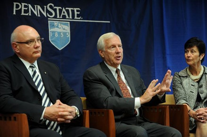 Penn State president Rodney Erickson, center, talks during an interview with the Centre Daily Times in State College, Pa., with interim athletic director Dave Joyner, left, and Board of Trustees chairwoman, Karen Peetz, on Monday, July 23, 2012. The NCAA crippled Penn State football for years to come, imposing an unprecedented $60 million fine and other punishments over the child sexual abuse scandal. (AP Photo/Centre Daily Times, Christopher Weddle)