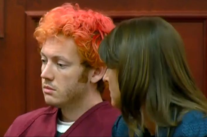 In this image taken from video provided by KUSA.com, James Holmes, left, the suspected gunman in Friday's Colorado theater massacre, makes his first appearance in court with his attorney Tamara Brady in Centennial, Colo., on Monday, July 23, 2012. (AP Photo/KUSA.com)