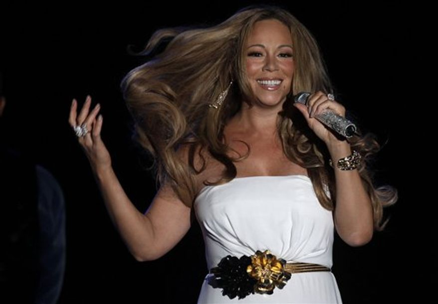 """** FILE ** In this June 2, 2012 photo, American singer, songwriter, record producer, and actress, Mariah Carey performs during a concert in Monaco. It was announced on Monday, July 23, 2012 that Mariah Carey will be a new judge on Fox's """"American Idol"""" TV show. (Associated Press)"""