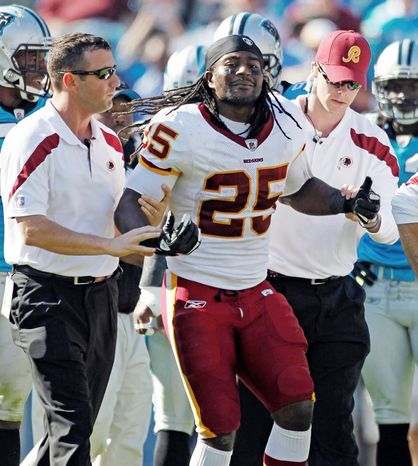 Washington Redskins' Tim Hightower (25) is helped from the field after being injured during the third quarter of an NFL football game against the Carolina Panthers in Charlotte, N.C., Sunday, Oct. 23, 2011. (AP Photo/Bob Leverone)