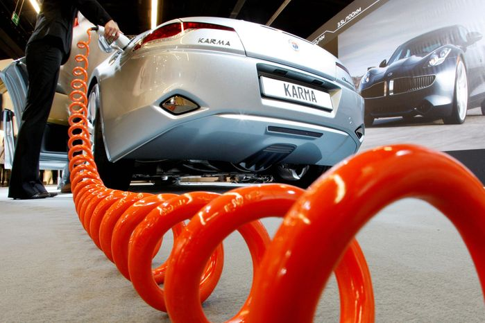 ** FILE ** A Fisker plug-in hybrid car is exhibited at the Frankfurt Auto Show in Germany in 2009. (Associated Press)