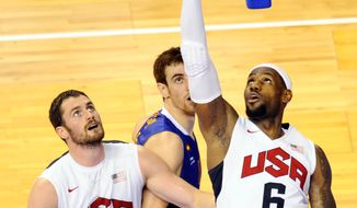 Lebron James, right, of the US Men's Senior National Team, right, dives for the ball against Victor Claver, center, of Spain Men's Senior National Team during an exhibition match between Spain and the United States Tuesday, July 24, 2012, in Barcelona, Spain, in preparation for the 2012 Summer Olympics. (AP Photo/Manu Fernandez)