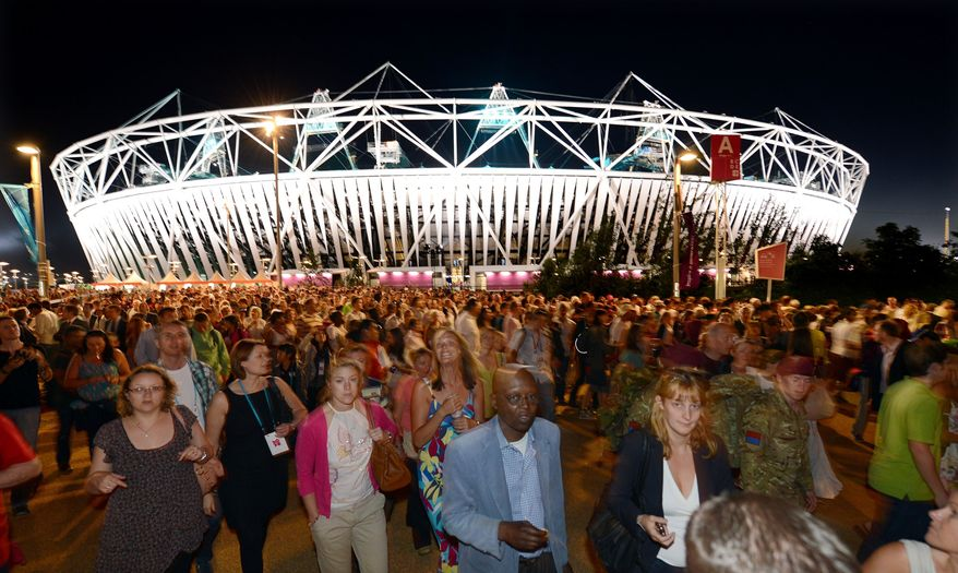 Crowds leave the Olympic Stadium at the Olympic Park in London on July 23, 2012, following the dress rehearsal for the opening ceremony for the 2012 Olympic Games. (Associated Press)