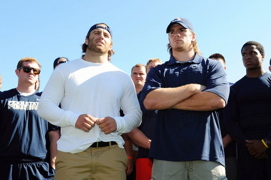 Penn State senior running back Michael Zordich, left, and senior linebacker Michael Mauti, right, give a statement in support of their team, as other players look on, Wednesday, July 25, 2012 in State College, Pa. (AP Photo/The Centre Daily Times, Nabil K. Mark) MAGS OUT MANDATORY CREDIT