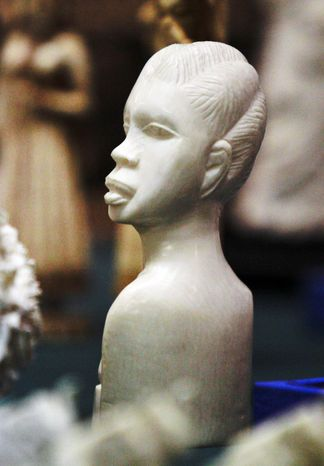 This carving is a tiny part of a $2 million haul of illegal elephant ivory that resulted in guilty pleas from two New York dealers. (Associated Press)