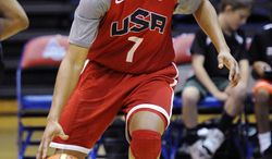 At 23, Maya Moore is the youngest member of the U.S. women's team that will begin its quest for a fifth straight gold medal Saturday at the 2012 London Olympics. (AP Photo/Nick Wass)