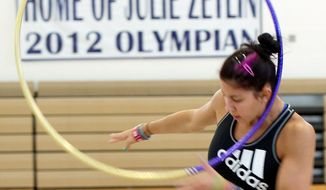 Bethesda native Julie Zetlin, shown practicing at the Katie Fitzgerald Youth Recreation Center in Darnestown, will be the first U.S. rhythmic gymnast to compete in the Olympics since the 2004 Athens Games. The 22-year-old won gold at the Pan-American Games last year, but her expectations for London are tempered: No U.S. gymnast has medaled in the sport at the Olympics.  (Barbara L. Salisbury/The Washington Times)