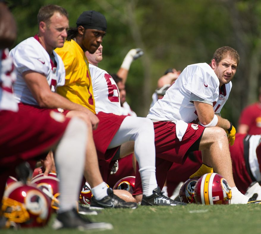 Washington Redskins tight end Chris Cooley (center) stretches during afternoon practice on the first day of training camp at Redskins Park in Ashburn. Cooley, who is entering his ninth season, is coming back from injuries that limited him to just five games in 2011. (Andrew Harnik/The Washington Times)