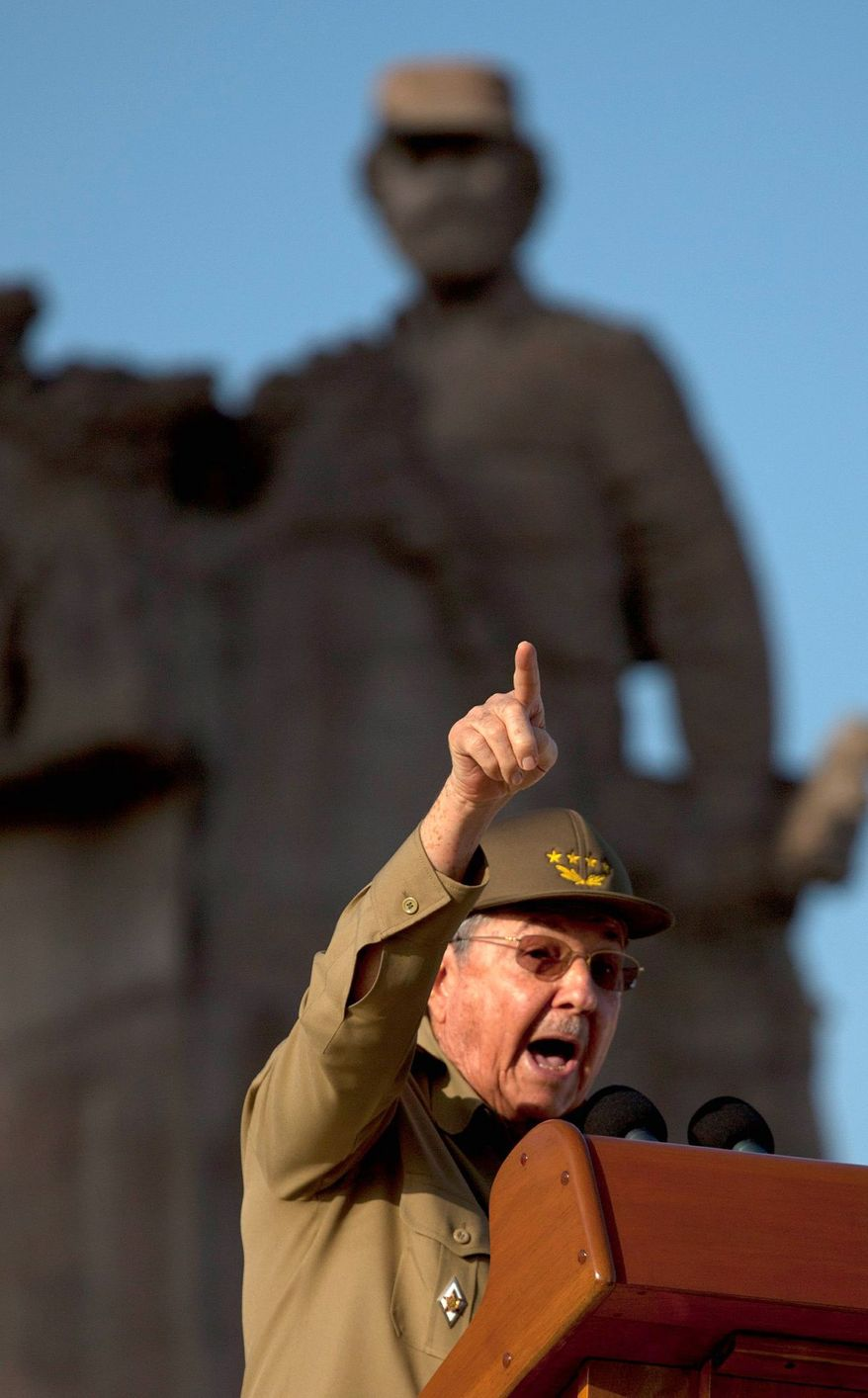 ** FILE ** In this file photo from July 26, 2012, Raul Castro speaks in Guantanamo on Revolution Day, the anniversary of the July 26, 1953, rebel attack on a military barracks led by Fidel and Raul Castro that is considered the beginning of the Cuban revolution. (Associated Press)