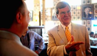 ** FILE ** Former U.S. Senate Majority Leader Trent Lott sports a seersucker suit as he hosts Seersucker Thursday at Occidental Grill & Seafood in Washington in 2012. Mr. Lott started the tradition in 1996 as a way to promote friendly relations among senators who might disagree on political issues. (The Washington Times)