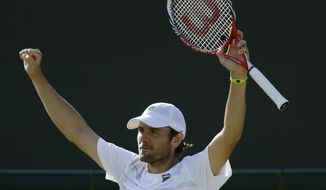 Mardy Fish of United States reacts as he wins against David Goffin of Belgium in a third round men's singles match at the All England Lawn Tennis Championships at Wimbledon, England, Saturday, June 30, 2012. (AP Photo/Sang Tan)