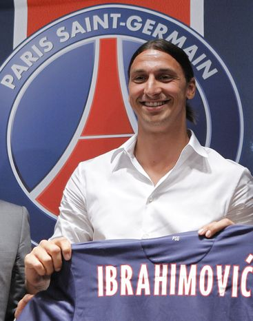New PSG striker Zlatan Ibrahimovic, of Sweden, holds his jersey during a press conference at the Parc des Princes stadium in Paris, Wednesday, July 18, 2012 after signing an agreement with the Paris Saint Germain (PSG) club. Ibrahimovic will be the Ligue 1 club's third major signing of the summer, following the arrivals of former AC Milan teammate Thiago Silva and Napoli's Ezequiel Lavezzi. (AP Photo/Jacques Brinon)