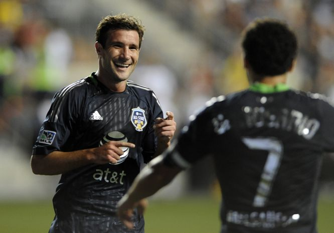 MLS All-Stars' Chris Pontius, left, of D.C. United, celebrates a goal with Dwayne De Rosario, also of D.C. United, during the MLS All-Star game against Chelsea FC, Wednesday, July 25, 2012 in Chester, Pa. The MLS All Stars won, 3-2. (AP Photo/Michael Perez)