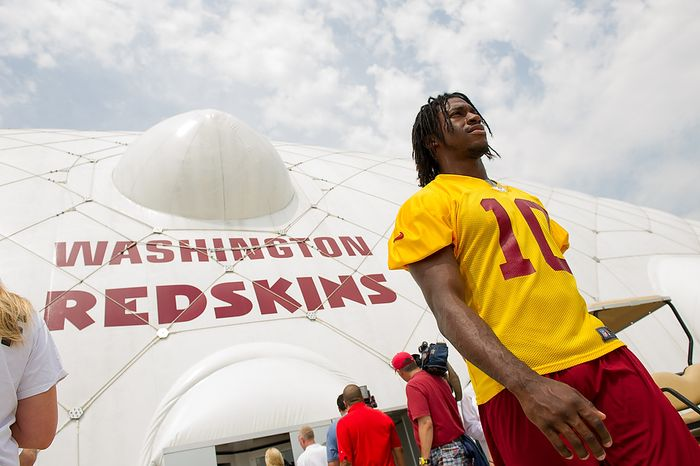 Washington Redskins quarterback Robert Griffin III (10) leaves the indoor training dome as the Washington Redskins finish morning walkthroughs on the first day of training camp at Redskins Park, Ashburn, Va., Thursday, July 26, 2012. (Andrew Harnik/The Washington Times)