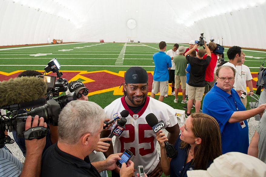 Washington Redskins running back Tim Hightower (25) speaks with members of the media following morning walkthroughs on the first day of training camp at Redskins Park, Ashburn, Va., Thursday, July 26, 2012. (Andrew Harnik/The Washington Times)