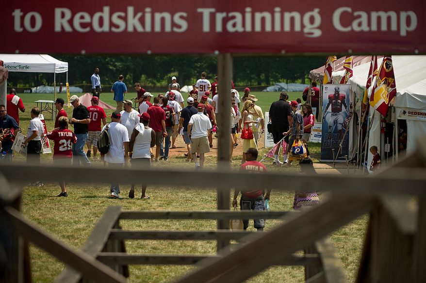 Fans arrive for the first day of training camp at Redskins Park, Ashburn, Va., Thursday, July 26, 2012. (Andrew Harnik/The Washington Times)