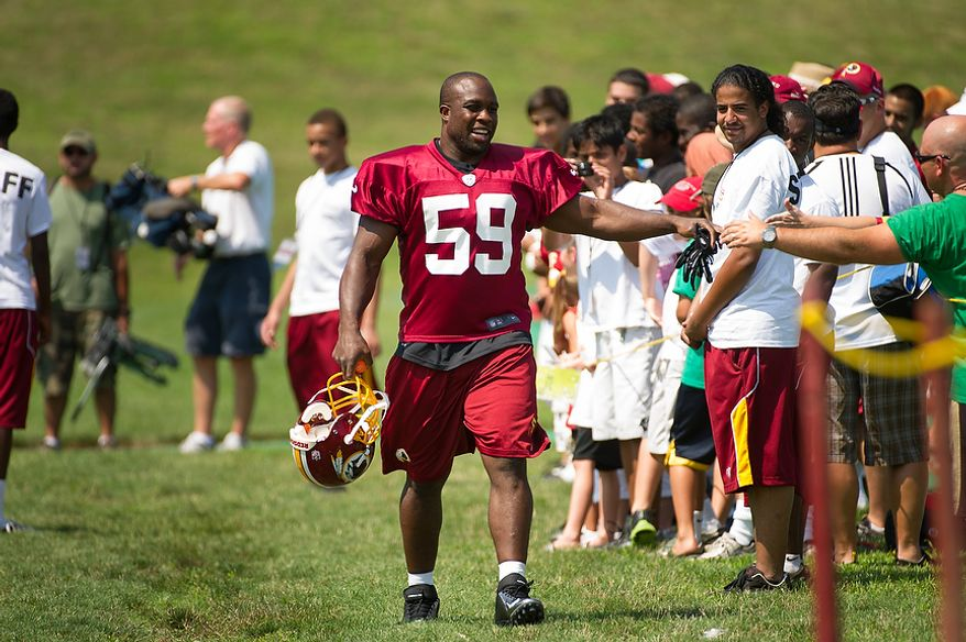 Washington Redskins linebacker London Fletcher (59) makes his way to the field for afternoon practice on the first day of training camp at Redskins Park, Ashburn, Va., Thursday, July 26, 2012. (Andrew Harnik/The Washington Times)