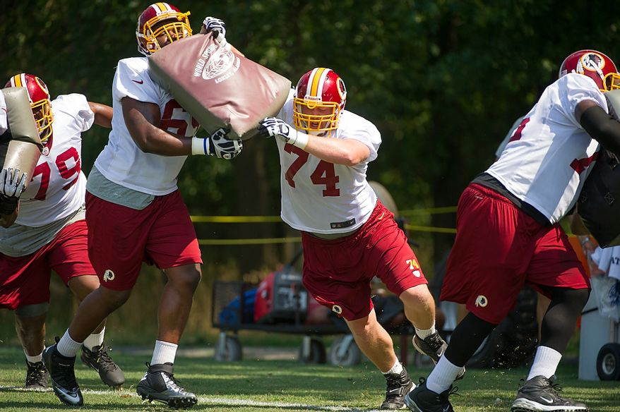 Washington Redskins offensive tackle Tyler Polumbus (74), center, works out during afternoon practice on the first day of training camp at Redskins Park, Ashburn, Va., Thursday, July 26, 2012. (Andrew Harnik/The Washington Times)