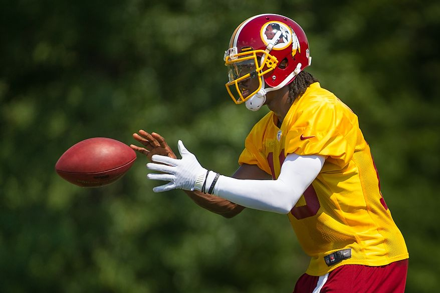 Washington Redskins quarterback Robert Griffin III (10), during afternoon practice on the first day of training camp at Redskins Park, Ashburn, Va., Thursday, July 26, 2012. (Andrew Harnik/The Washington Times)