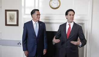 Republican presidential candidate and former Massachusetts Gov. Mitt Romney, left, meets with British opposition leader Ed Miliband in London, Thursday, July 26, 2012. (AP Photo/Charles Dharapak)