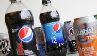 **FILE** Bottles of Pepsi Next and Pepsi Max are displayed among cans of 10-calorie sodas from PepsiCo., on  June 11, 2012, in New York. (Associated Press)